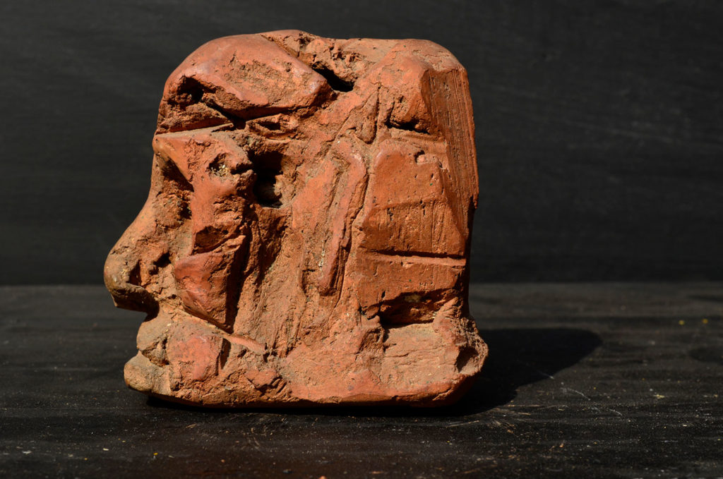 <em><strong>Head 1</strong></em>. Terracotta, 4 x 3 x 3.5 inches
